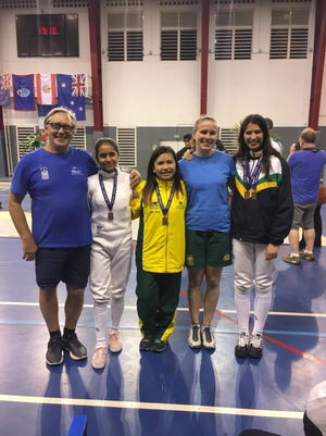 Anica Camacho, second from left, is shown with her Australian teammates after winning the bronze medal in the 2017 Oceania Cadet Championships, held over the weekend in Noumea, New Caledonia over the weekend.  Leon Thomas, at left, was the Team Guam coach for the event. He has visited Guam twice to certify six coaches at Level 1 Fencing.
