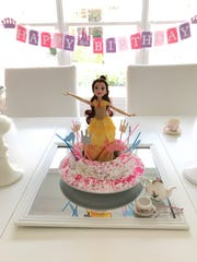 A Southern pound cake with a Princess Belle theme is