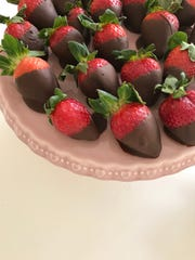 Chocolate-dipped strawberries add a delicious element