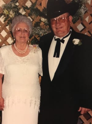 Hollis and Betty Dean pose for their 65th wedding anniversary picture.