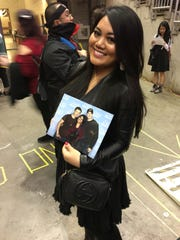 Gemma Resaba, 27, of Illinois, holds up her photo with Sebastian Stan and Chris Evans.
