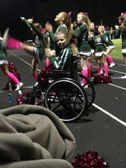 Samantha Campbell cheers from her wheelchair during