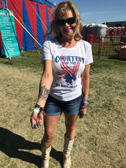 Karen Larsen, who attended the Route 91 Harvest Festival in Las Vegas, shows off her commemorative tattoo at Country Thunder Arizona Festival 2018 in Florence. The 60-year-old retiree from Utah was disappointed Jason Aldean didn't acknowledge the tragedy during his Friday night concert.