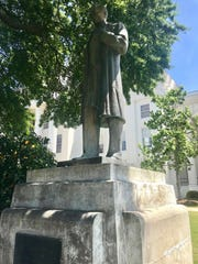 A statue of Dr. J. Marion Sims is seen on the grounds