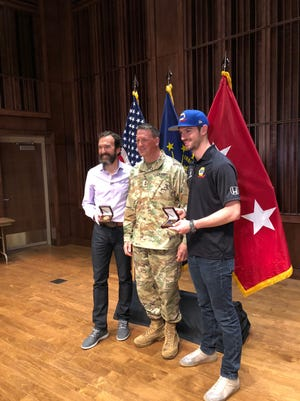 2016 Indianapolis 500 winner Alexander Rossi, right, thanks and recognizes military veterans.