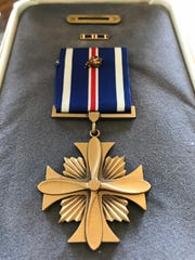 "The Distinguished Flying Cross with bronze oak leaf cluster is among the military decorations earned by Lt. Col. Robert G. Nopp of Salem during the Vietnam War. The medal is awarded to any member the United States Armed Forces who distinguishes himself or herself in support of operations by ""heroism or extraordinary achievement while participating in an aerial flight."" The oak leaf cluster designates a second award."