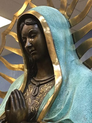 The statue of the Virgin Mary inside Our Lady of Guadalupe Church Sunday shows signs of weeping from her eyes. Parishioners witnessed the statue crying during the church's noon mass.