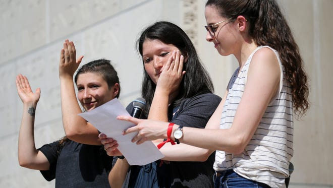 Jenna Register, Shirlene Wade and Lindsay Wrobel speaks to a gathering of UR students during a protest Wednesday over  dissatisfaction of UR's handling of sexual harassment allegations against professor.