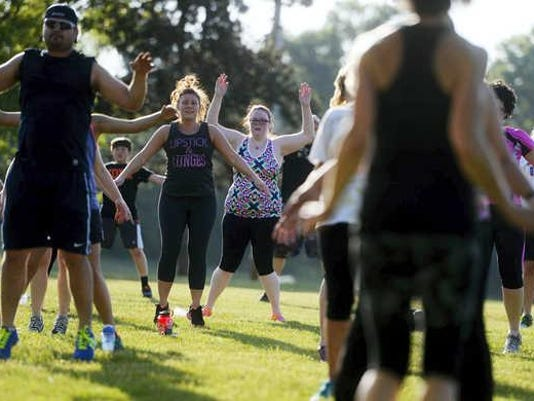 About 100 people kicked and punched along with Jen Kuhn as she led a kickboxing class during No Sweat in the Park at the York Daily Record/Sunday News in West Manchester Township Tuesday, May 19, 2015. Kate Penn — Daily Record/Sunday News