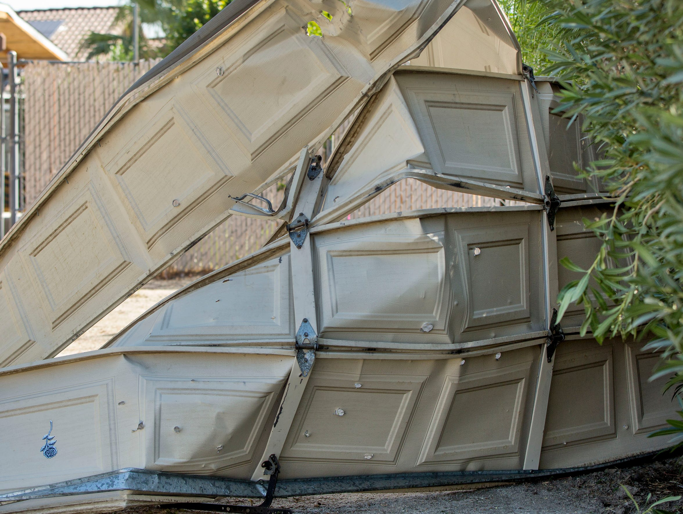 A destroyed garage door from a home on N. Cypress Road