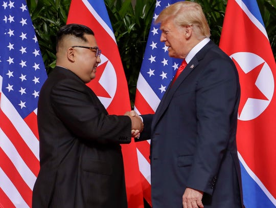 President Trump shakes hands with North Korea leader