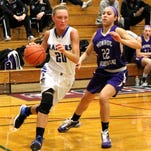 Marlea Nolan of Horseheads drives to the basket while guarded by Monroe-Woodbury's Justine Crespo during the Blue Raiders' win Tuesday.