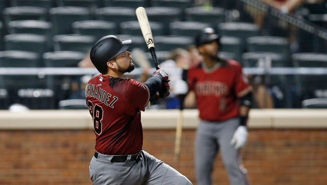 Arizona Diamondbacks' Oscar Hernandez watches his 12th-inning solo home run off New York Mets relief pitcher Jerry Blevins in a baseball game, Wednesday, Aug. 10, 2016, in New York.