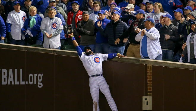 Chicago Cubs right fielder Jason Heyward (22) makes a catch against Cleveland Indians starting pitcher Trevor Bauer (not pictured) for an out during the third inning in game four of the 2016 World Series at Wrigley Field.