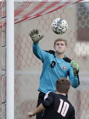 Seymour's Michael Kuehne (0) makes a save against Fox Valley Lutheran in a D3 sectional final soccer match at Seymour High School.