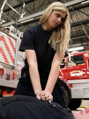 Recruit firefighter Kelly Krause participates in a CPR training exercise Tuesday at a Howard Fire Station.