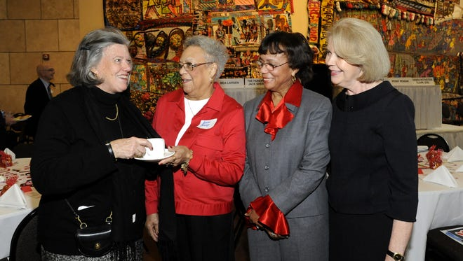 Francie Pepper of Wyoming (left), sips coffee with Jeane Goings of Kennedy Heights, Barbara Smitherman of Avondale and YWCA President and CEO, Charlene Ventura, at the Heart-to-Heart racial justice breakfast held at the National Underground Railroad Freedom Center in 2009.