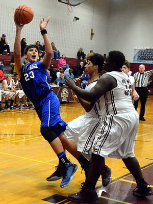White House Middle's Zak Lamaal attempts to shoot after being fouled by Rucker-Stewart's Brythawn Bell (32) during second-quarter action. Lamaal scored six points.