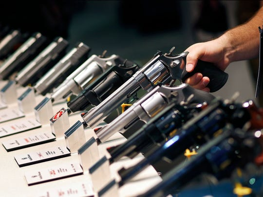 Handguns are displayed at a trade show in Las Vegas