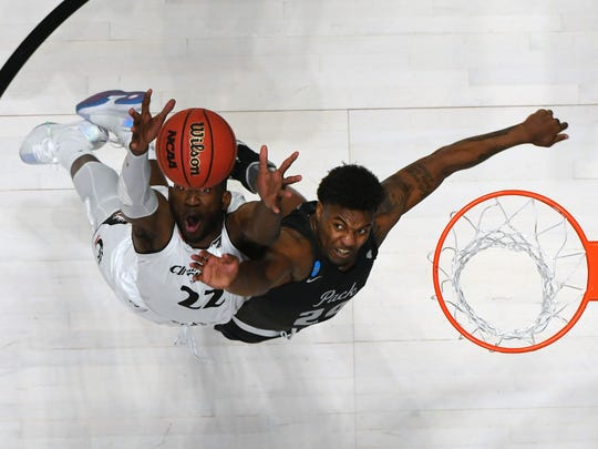 Nevada's Jordan Caroline fights for a rebound against Cincinnati in last season's NCAA Tournament.
