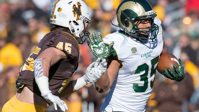 CSU running back Izzy Matthews sets his eye on the end zone during a game against Wyoming at War Memorial Stadium in Laramie, Wy. Saturday, November 7, 2015.
