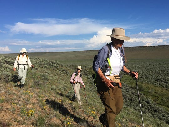Julie Weikel, Helen Harbin and Alice Elshoff descend a ridge into Catnip Canyon on the Sheldon National Wildlife Refuge. The three women recently completed a 50-mile hike in the Nevada and Oregon deserts.