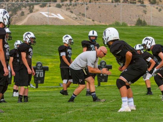 Canyon View head football coach Skyler Miller leads