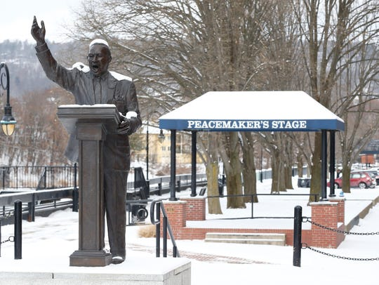 Snow covers the statue of Martin Luther King Jr. on the Riverwalk in Binghamton on Thursday.