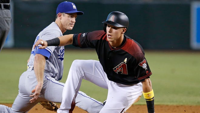 Arizona Diamondbacks' Jake Lamb, right, is forced out at second base by Los Angeles Dodgers infielder Chase Utley  during the first inning of a baseball game Saturday, Sept. 17, 2016, in Phoenix.