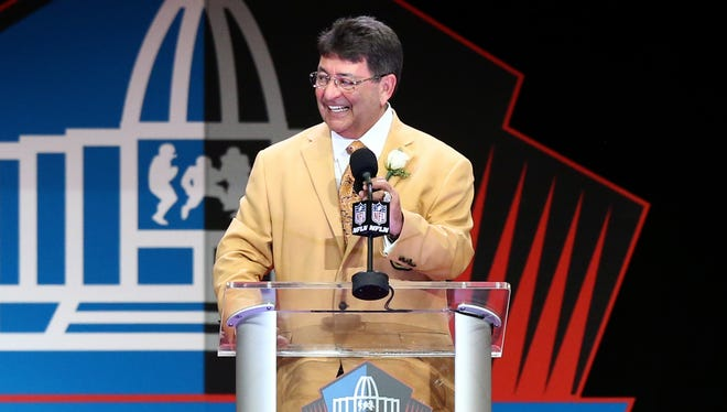 Eddie DeBartolo gives his acceptance speech during the Pro Football Hall of Fame enshrinement.