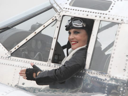 Ann Reinking, original cast member of Chicago the Musical, poses in a vintage airplane during a photo shoot at Westchester County Airport Nov. 18, 2015. They were shooting promotional photos celebrating the 20th year of the show.