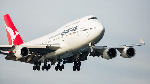 DOT fines Qantas: no foreign airline flights between U S  cities
