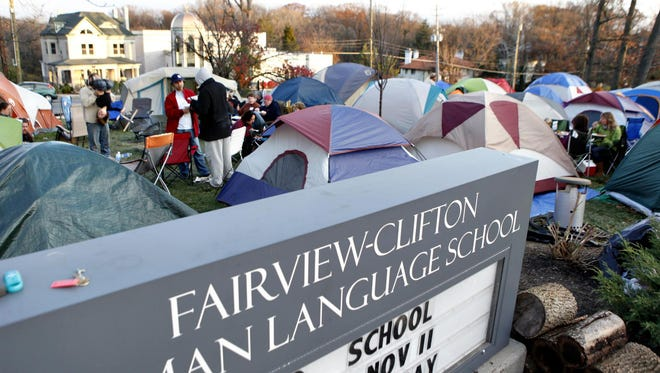 In 2011, tents fill the front yard of Fairview-Clifton German Language School, as parents hold spots in line for enrollment. Campouts became a tradition at some hard-to-get-into magnet schools, but this year, CPS is switching to an online lottery versus first-come, first-served.