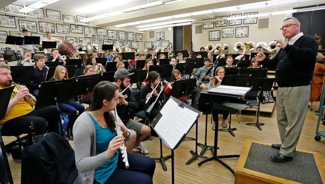 Jay Gephart conducts the Purdue Wind Ensemble as it rehearses in Elliott Hall of Music Monday, March 21, 2016, for it's upcoming concert at Carnegie Hall. The performance at Carnegie Hall is part of a spring festival.