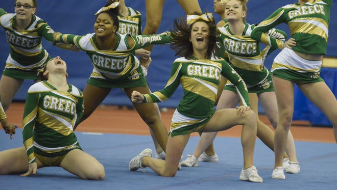 A file photo of the Greece Olympia varsity cheerleading team at a sectional championship.