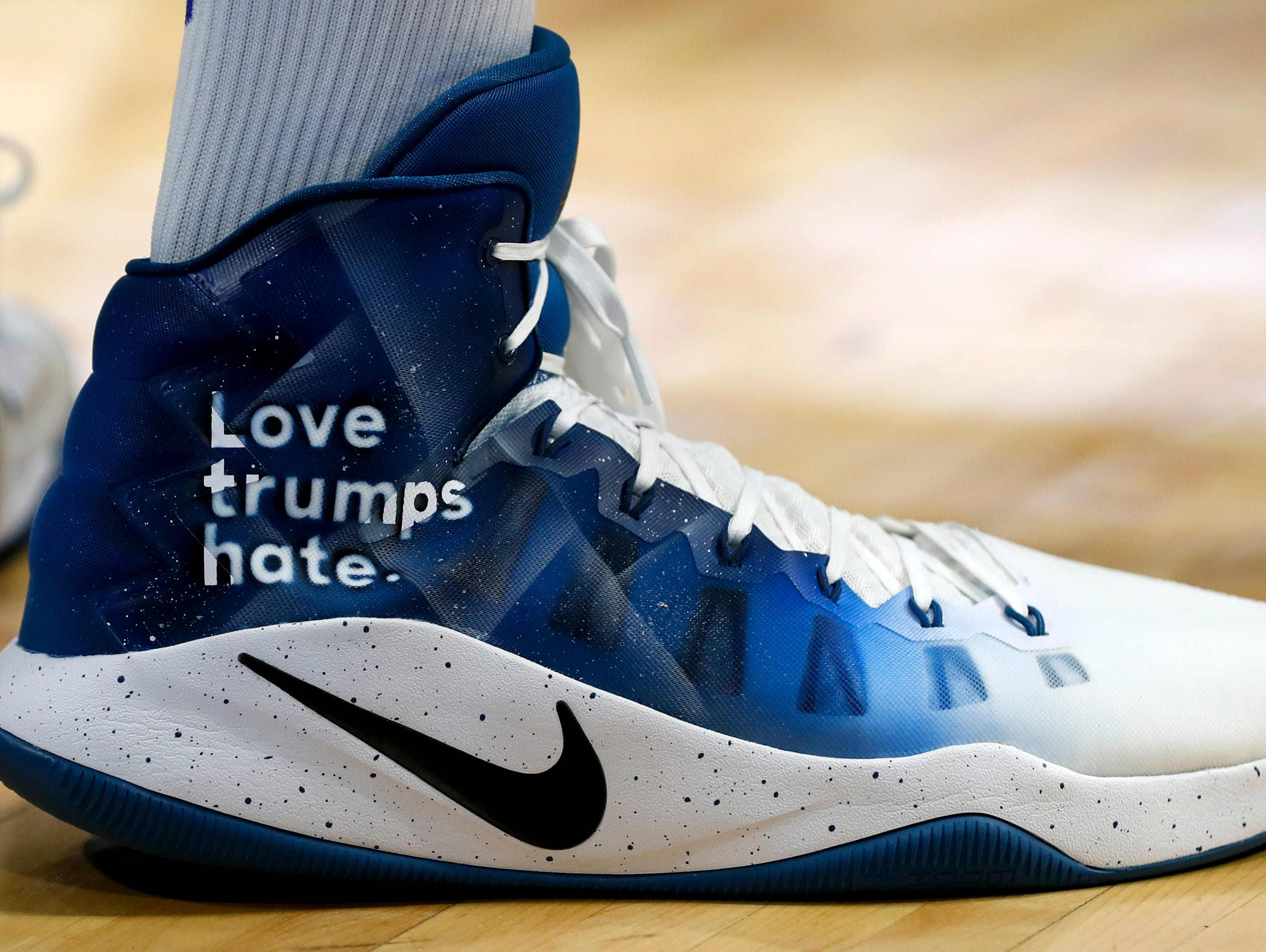 Karl-Anthony Town wore Love trumps hate on his shoes during Kentucky's Alumni game. Aug. 25, 2017