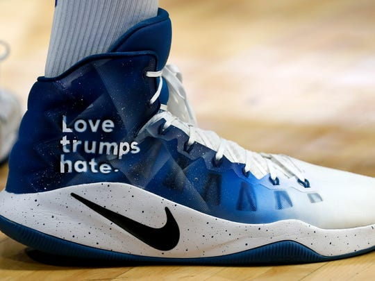 Karl-Anthony Town wore Love trumps hate on his shoes during Kentucky's Alumni game. 