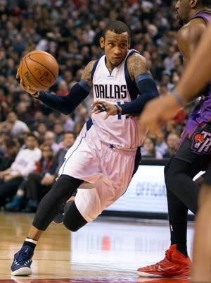 Monta Ellis  goes to the basket against Raptors forward Patrick Patterson.