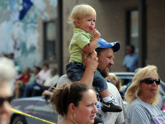 Hundreds lined downtown Canton Monday morning to watch
