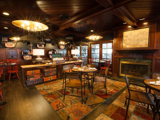 A fireplace warms one of the dining areas at Tuckers