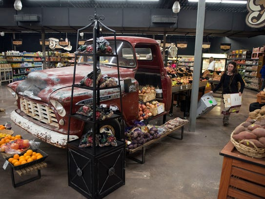 An old Chevy pick-up turned, grocery display sits inside
