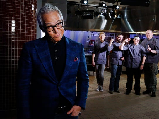 Host Geoffrey Zakarian poses with competitors as seen
