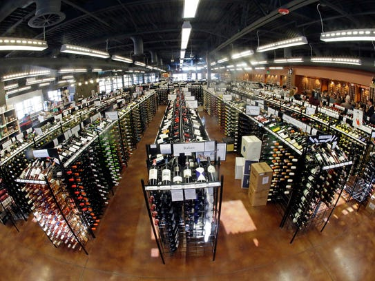 Bottles of wine are displayed during a tour of a state
