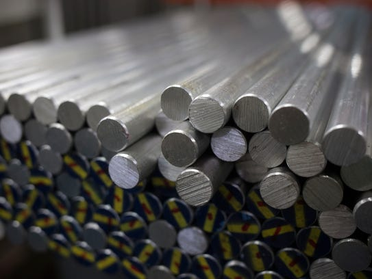 Aluminum bar that will be machined into pens is stacked