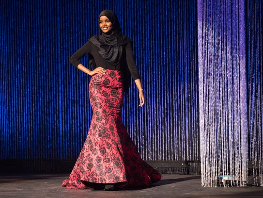 Halima Aden wears a hijab and gown while competing