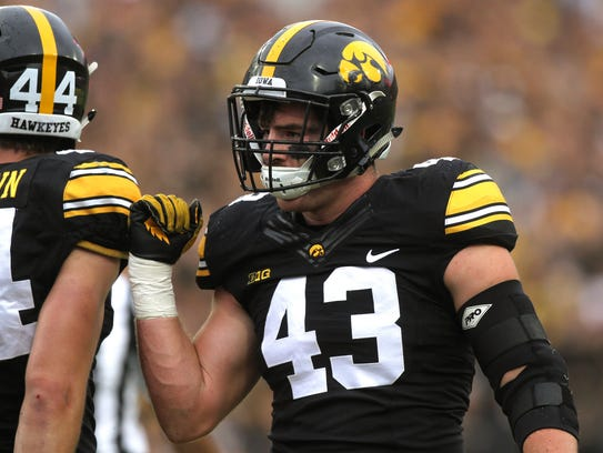 Iowa linebacker Josey Jewell celebrates a stop on third