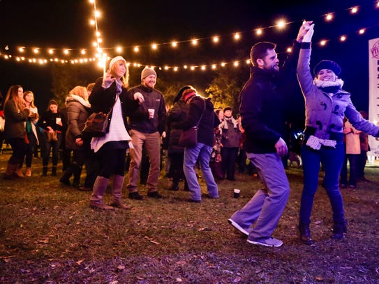 Dancers enjoy The Lost Bayou Ramblers during Christmas