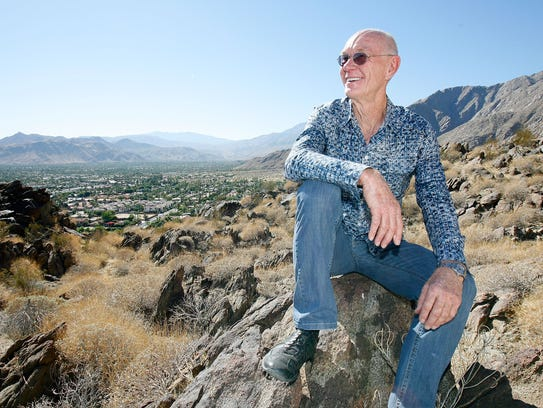 John Wessman poses for a photo above downtown Palm