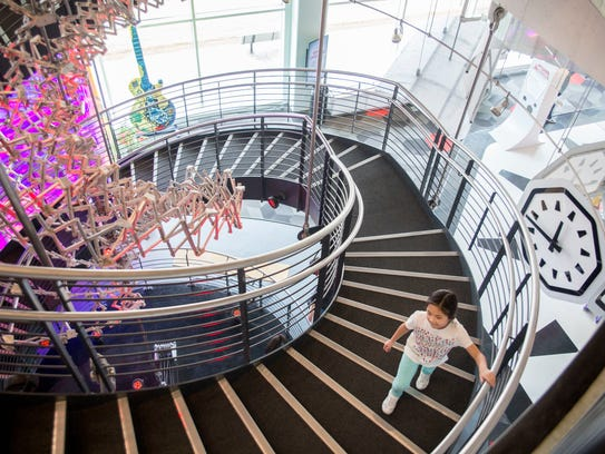 Katelyn experiences the double helix staircase at Discovery