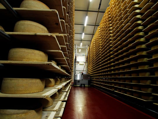 Wheels of Grand Cru Surchoix cheese sit on spruce planks